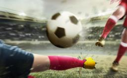 football player man kicking the ball